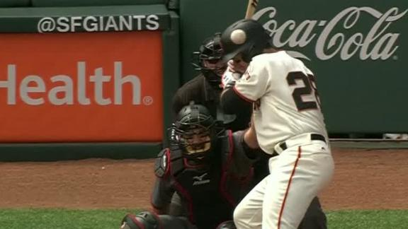 Posey exits game after taking pitch to head