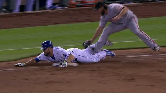 Moustakas' hustle results in game's first run