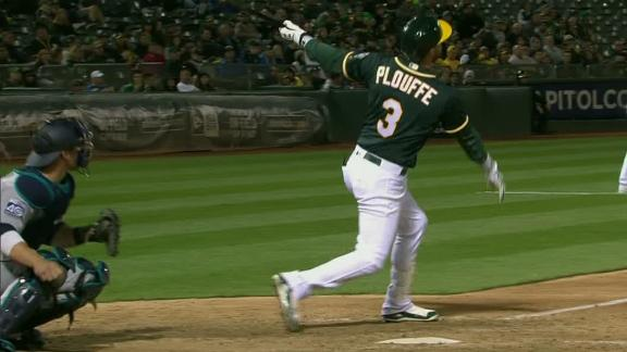 Plouffe's long ball extends A's lead