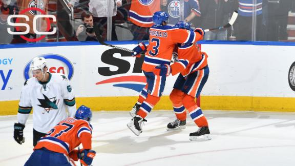 Oilers storm past Sharks for OT win