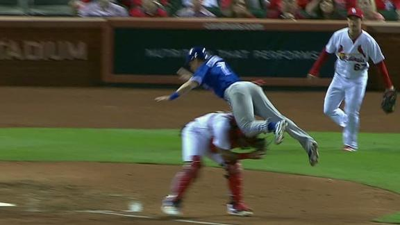 Coghlan leaps over Molina and tumbles in for the run