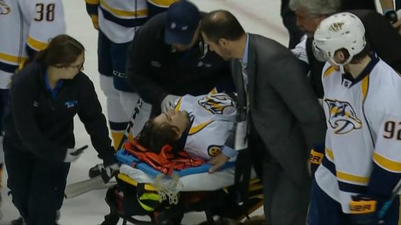 Fiala carted off the ice