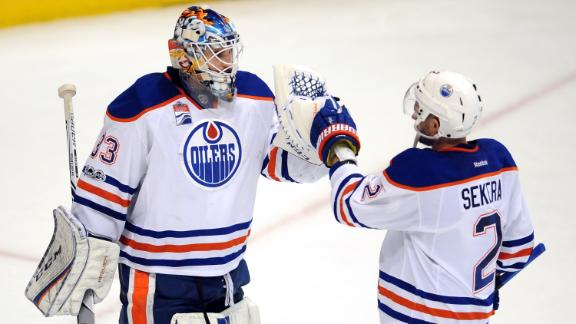 Larsson leads Oilers past Ducks 5-3 in wild series opener