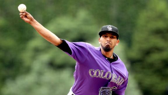 Marquez gets it done on mound, at plate for Rockies