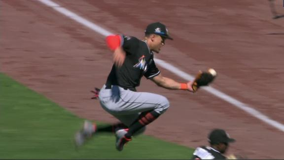 Stanton leaps over Gordon to make catch