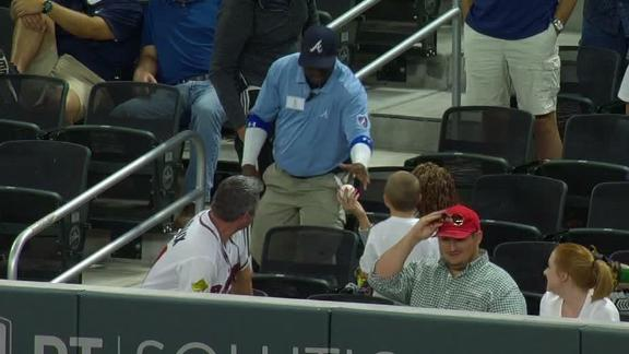 Security guard takes ball from kid