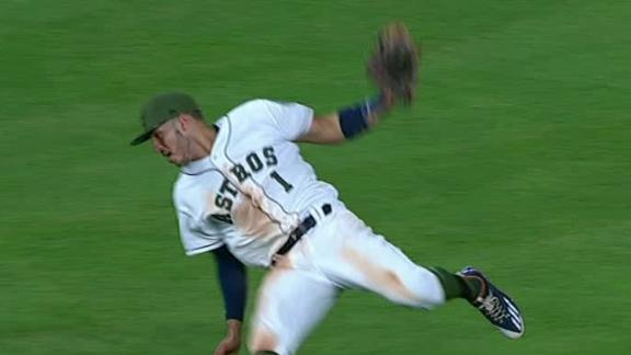 Correa 'turned himself into a pretzel to catch that one'