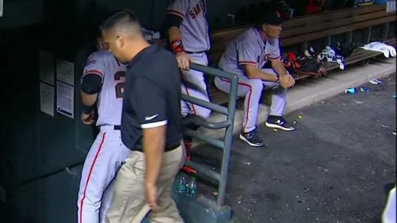Posey limps off field after hitting homer
