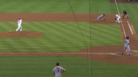 Cardinals take lead on throwing error