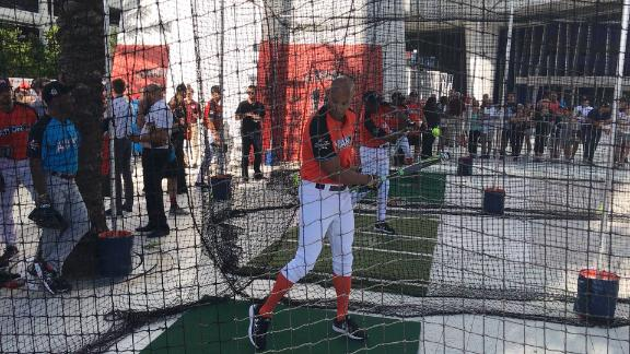 Former Miami Dolphin Jason Taylor gets in the cage for a few