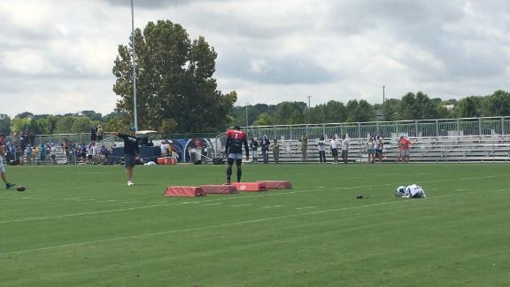Newton takes part in QB drill during practice