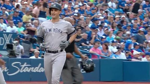 Yanks clinch playoff berth after topping Jays