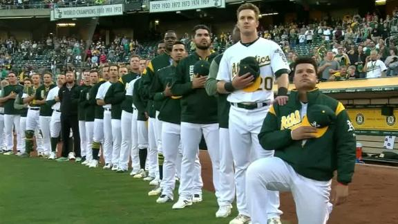 Athletics catcher kneels for national anthem