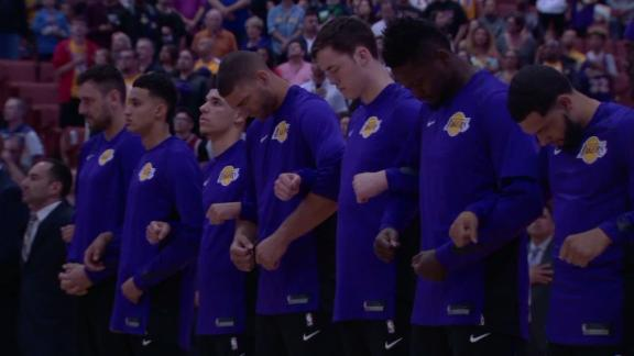 Lakers stand in unity during national anthem