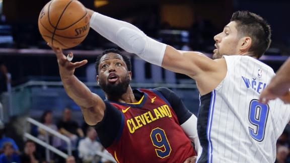 Wade, Rose lead Cavs past Magic