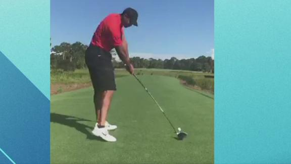 Woods takes a swing with his driver