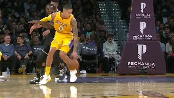 Kuzma spins and scoops it in