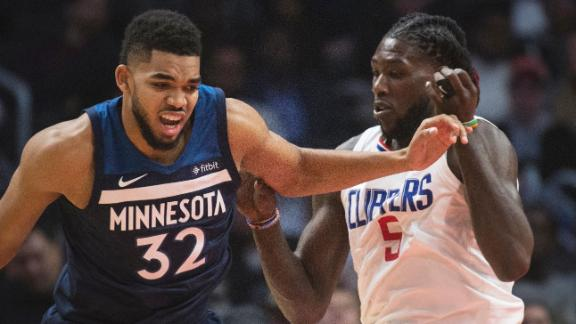 Towns helps Wolves hold off Clippers