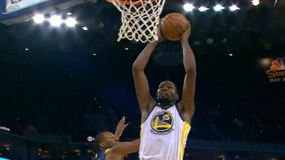 Durant drives for a two-handed slam