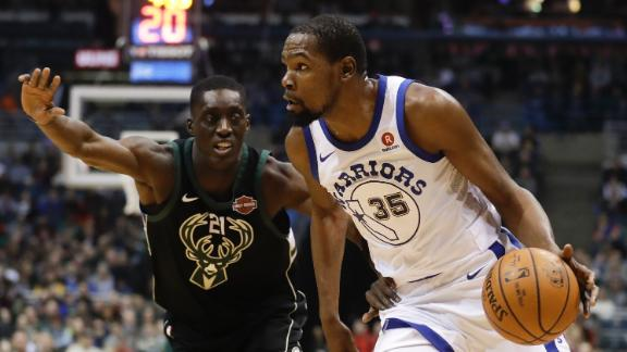 Durant, Warriors stifle Bucks late for victory