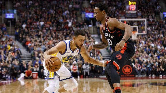 Warriors hold off Raptors' rally