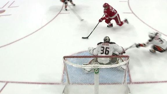 Bieksa's awful turnover sets up Larkin's goal