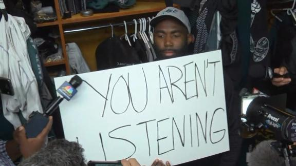 Jenkins 'answers' reporter's questions with signs