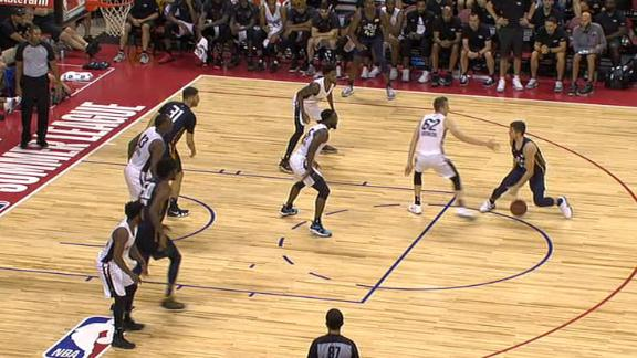 Allen creates space with step-back jumper