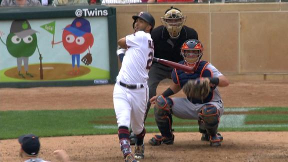 Rosario breaks tie with homer in 8th