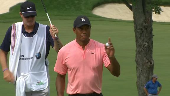 Tiger Woods chips shot to set him up for a birdie on the 11th hole dropping him to-9