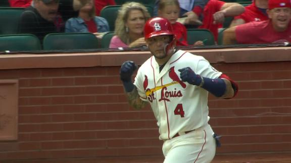 Molina ties game with 2-run blast