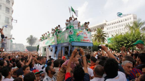 Algeria arrive home to hero's welcome