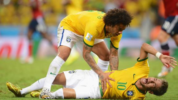 Neymar gets consoled by teammates