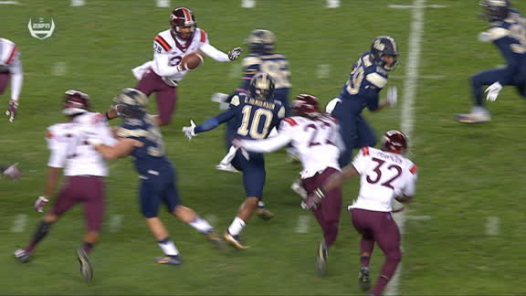 Offensive lineman takes the handoff and dives for a Pitt TD