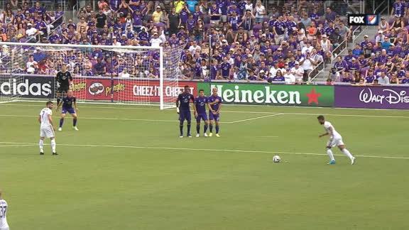 Dos Santos rips a free kick off the bar