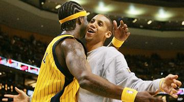 Jermaine O'Neal (L) and Reggie Miller