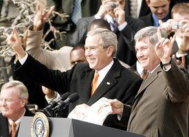 George W. Bush (left) and Mack Brown