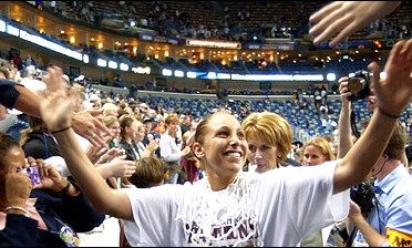 Nothing but net: UConn's Diana Taurasi celebrates her third straight national title.