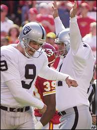 Sebastian Janikowski, right, drilled four field goals, including the