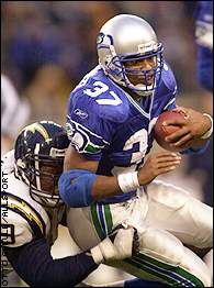 Shaun Alexander worked hard for his 87 yards, carrying 29 times.