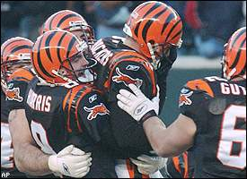 Bengals kicker Neil Rackers is lifted by holder Nick Harris after