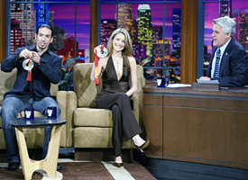 Ben Agosto, left, Tanith Belbin and Jay Leno