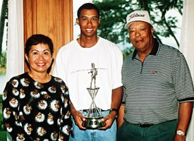 Tiger Woods and parents Kultida and Earl Woods.