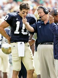Charlie Weis, right, and Brady Quinn