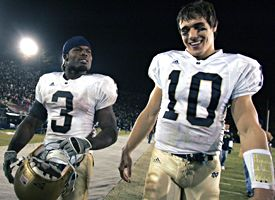 Brady Quinn, right, and Darius Walker.