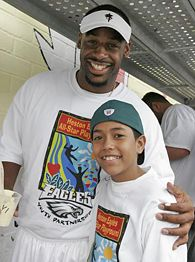 Donovan McNabb, left, and Charlie Pena