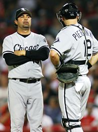 Ozzie Guillen, left, and A.J. Pierzynski