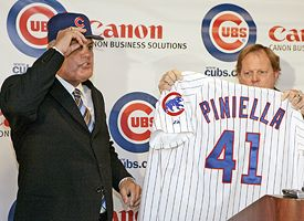 Lou Piniella, left, and GM Jim Hendry