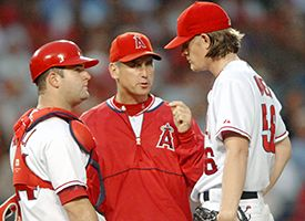 Bud Black, center, Mike Napoli, left, and Jered Weaver