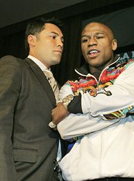Oscar De La Hoya and Floyd Mayweather Jr.